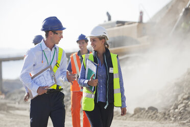 Business people talking in quarry - CAIF01408
