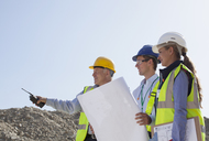 Business people talking in quarry - CAIF01432