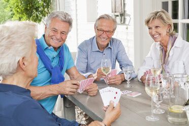 Friends playing card games at table - CAIF01477