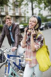 Woman fastening bicycle helmet - CAIF01543