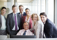 Business people smiling in office - CAIF01597