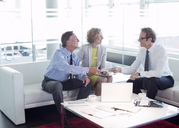 Business people talking office lobby area - CAIF01600