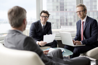 Businessmen talking in office area - CAIF01621
