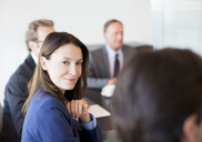 Businesswoman smiling in meeting - CAIF01624