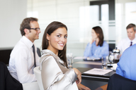 Businesswoman smiling in meeting - CAIF01648