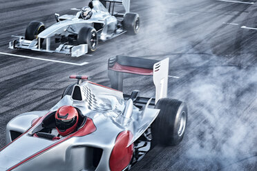 Race cars driving on track - CAIF01768
