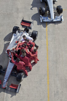 Race team surrounding racer on track - CAIF01774
