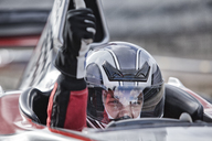 Racer giving thumbs up from car on track - CAIF01780