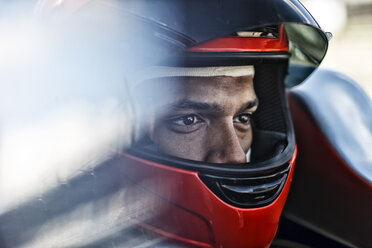 Racer sitting in car - CAIF01798