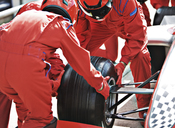 Racing team working at pit stop - CAIF01807