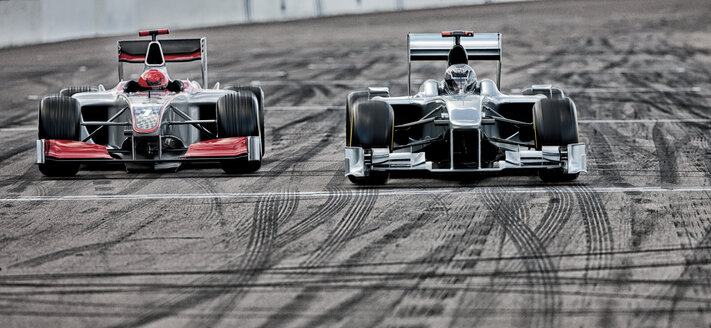 Race cars driving on track - CAIF01813