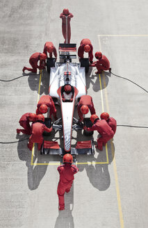 Racing team working at pit stop - CAIF01816