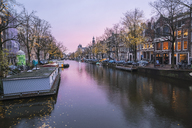 Netherlands, Holland, Amsterdam, houses on a canal in the evening - TAMF00924