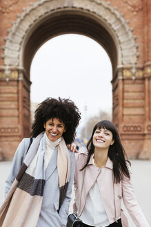 Spain, Barcelona, portrait of two happy women at a gate - EBSF02146
