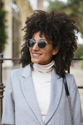 Portrait of smiling woman wearing sunglasses - EBSF02182