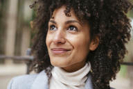 Portrait of smiling woman looking up - EBSF02185