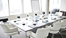 Table set for meeting in office - CAIF01828