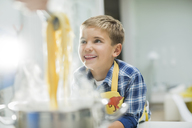 Boy smiling in kitchen - CAIF01924