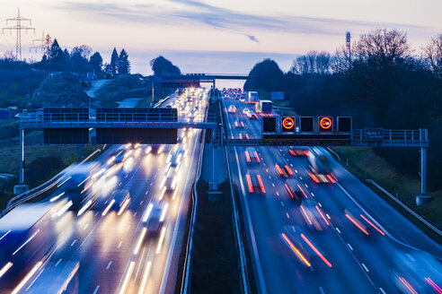 Germany, Baden-Wuerttemberg, Autobahn A8 near Wendlingen in the evening, light trails - WDF04473