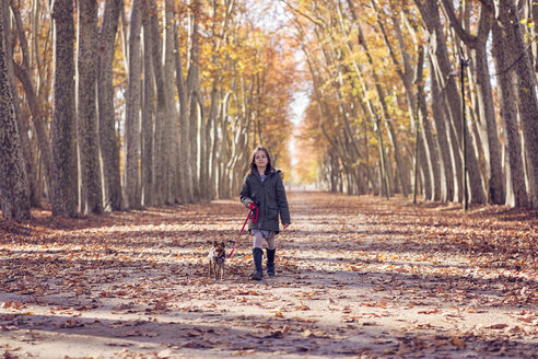 Spain, Girona, girl with her dog having a walk - XCF00168
