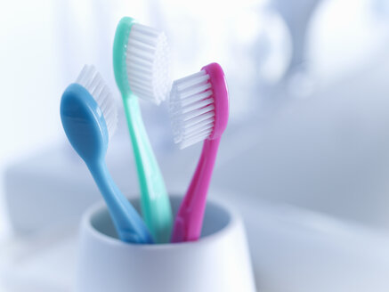 Close up of toothbrushes in holder - CAIF02084