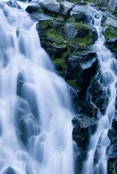 Waterfall rushing over rocky hillside - CAIF02138