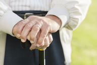 Close up of older man's hands on cane - CAIF02174
