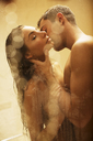 Nude couple kissing in shower - CAIF02264