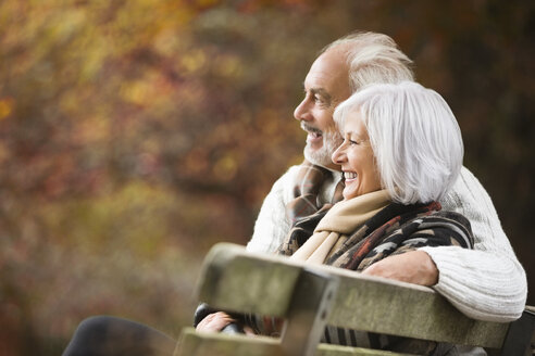 Older couple sitting on park bench - CAIF02285