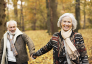 Older couple walking together in park - CAIF02315