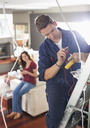 Electrician working in home - CAIF02414