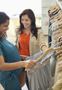 Women shopping together in clothes store - CAIF02471