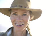 Portrait of smiling woman wearing a hat - ECPF00227