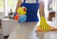 Woman cleaning kitchen counter - CAIF02542