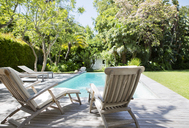 Lawn chairs and swimming pool in backyard - CAIF02632