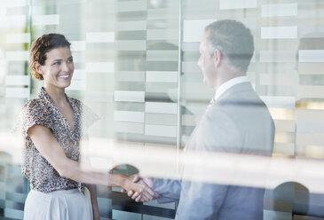 Business people shaking hands in office - CAIF02644