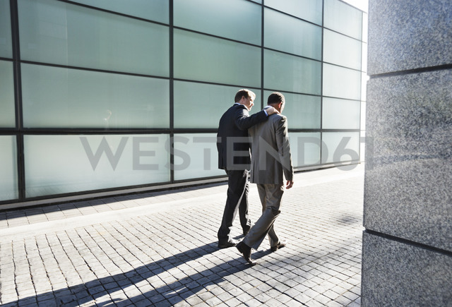 Businessmen talking on city street - CAIF02653