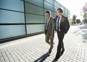 Businessmen walking on city street - CAIF02665