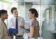 Business people talking in office - CAIF02668
