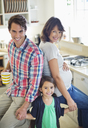 Family smiling together in kitchen - CAIF02695