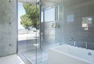 Shower and bath in modern bathroom - CAIF02734