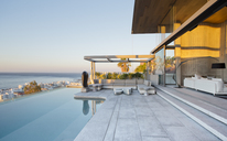 Infinity pool and patio of modern house - CAIF02743
