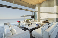 Sofas and table on modern patio - CAIF02746