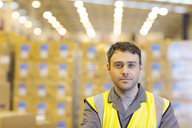 Worker standing in warehouse - CAIF02770