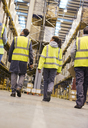 Workers walking in warehouse - CAIF02773