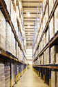 Aisle of boxes in warehouse - CAIF02794