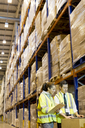 Workers talking in warehouse - CAIF02824