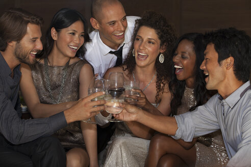 Friends toasting each other at party - CAIF02896