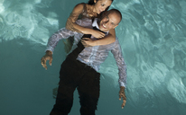 Fully dressed couple in swimming pool - CAIF02926
