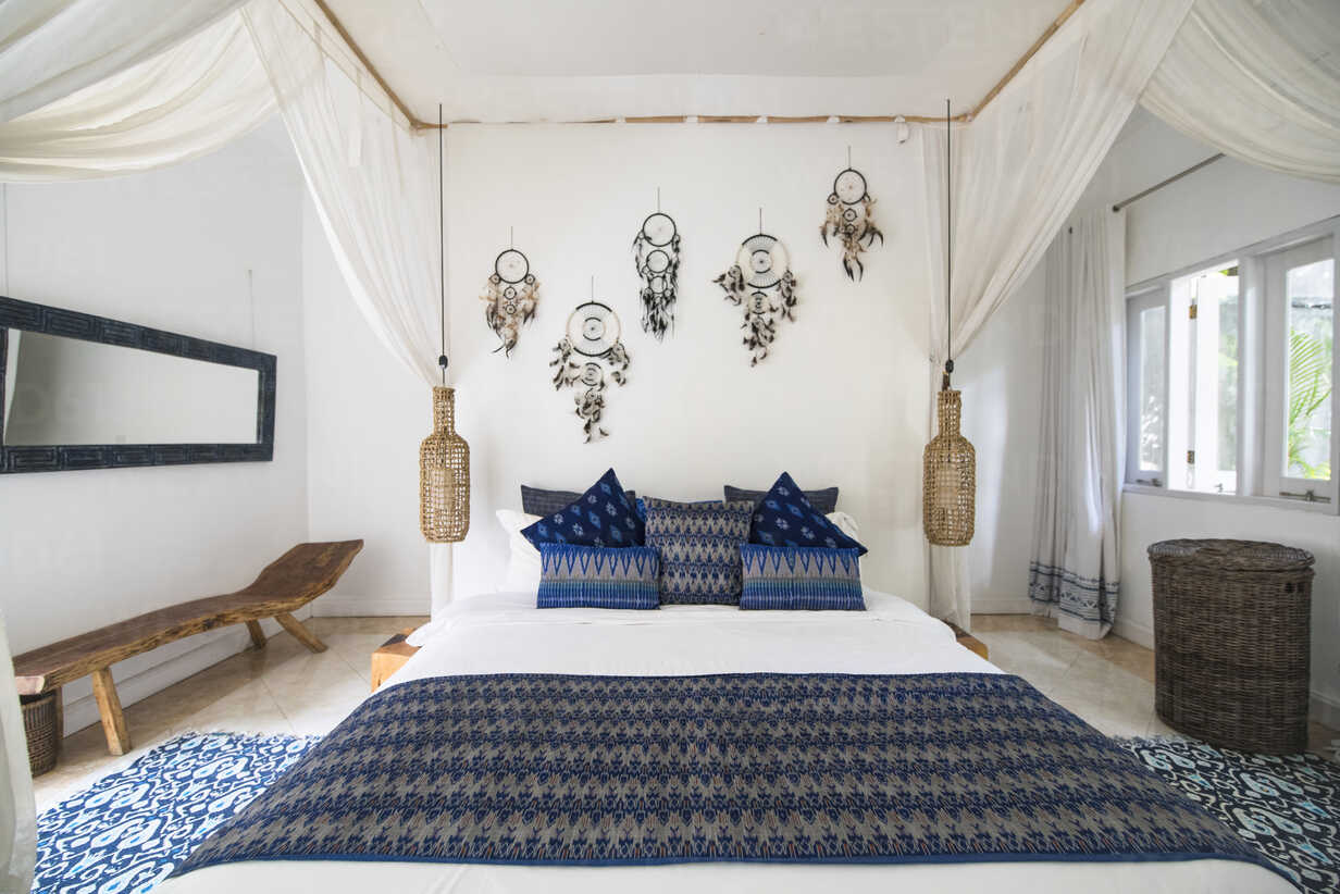 Cozy airy bedroom with blue pillows - SBOF01415 - Steve Brookland/Westend61
